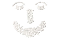 Pills Arranged in Shape of Face Royalty Free Stock Photos