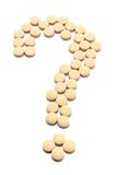 Pills Arranged  in Shape of Question Mark Stock Photo