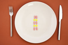 Pills as dinner on plate Royalty Free Stock Image