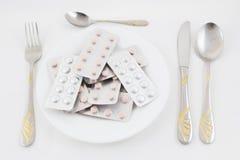 Pills as food Royalty Free Stock Photos