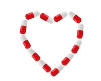 Pills as heart symbol isolated on white Royalty Free Stock Photo
