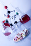 Pills and Atoms!. Atoms and flasks witch fluid in laboratory stock photo