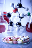 Pills and Atoms!. Atoms and flasks witch fluid in laboratory royalty free stock photography