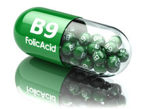Pills with b9 folic acid element. Dietary supplements. Vitamin c. Apsules. 3d Stock Photo