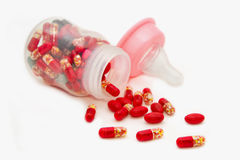 Pills in baby bottle Royalty Free Stock Image