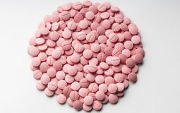 Pills background. Background of color pills for use in graphic design in medical applications, brochures, presentations and publications. pink color Stock Photo