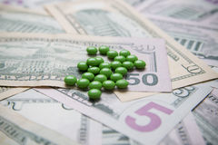 Pills on a background of money Stock Photos