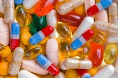 Pills. Background pattern of many oblong pills Royalty Free Stock Photo