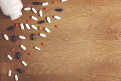 Pills background. Vitamins, dietary supplements, drugs, tablets on wooden table. Pharmacy, medicine and health concept. Vitamins, supplements, drugs, tablets Royalty Free Stock Image