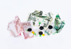 Pills and banknotes Royalty Free Stock Images