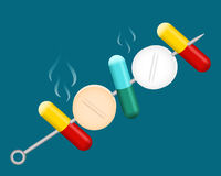 Pills barbecue. Pills and capsules stab on the skewer Stock Image