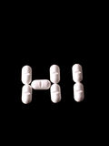Pills on black Stock Photos