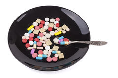 Pills in Black Plate Royalty Free Stock Image