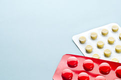 Pills in a Blister. Assorted colorful pills and capsules in a Blister packaging on a light background close up, horizontal, copy space, selective focus, medical Stock Photo