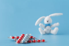 Pills in blister on blue background Stock Photos