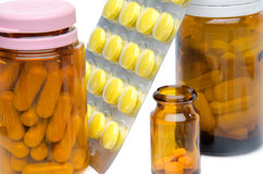 Pills in blister pack and bottles Royalty Free Stock Image