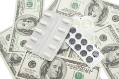 Pills in a blister pack and US dollars Royalty Free Stock Photos