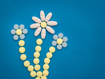 Pills on the blue background Stock Photo