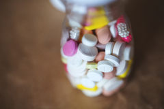 Pills in bottle. Stock Photos