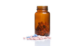 Pills and bottle Stock Image