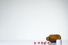 Pills bottle and pills Royalty Free Stock Photos