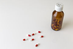 Pills bottle and pills Stock Images