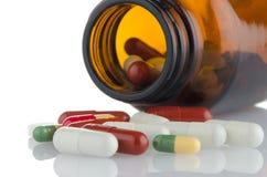 Pills from bottle Stock Image