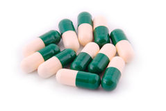 Pills from bottle on the white Royalty Free Stock Photography
