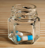 Pills in a bottle Royalty Free Stock Image