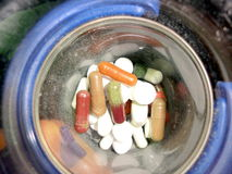 Pills in bowl. A close up of different pills in a bowl Stock Images