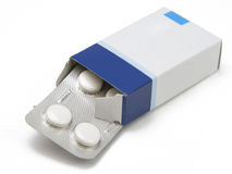 Pills box. Image of a pills blister getting out form the box over white background with shadow Stock Image