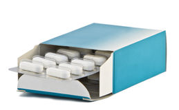 Pills box. Image of a pills blister getting out form the box over white background Royalty Free Stock Photos