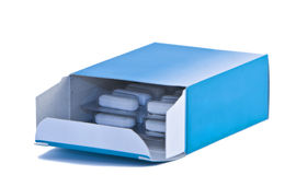 Pills box. Opened pills box with blisters of medicines isolated against a white background royalty free stock photography