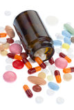 Pills and brown bottle Royalty Free Stock Photos