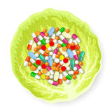 Pills on cabbage leaf Royalty Free Stock Photography