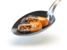 Pills with calcio calcium CA element in the spoon. Dietary suppl. Ements. Vitamin capsules. 3d illustration Stock Images