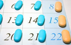Pills on calendar Royalty Free Stock Photos