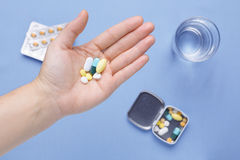 Pills and capsule on hand Stock Image