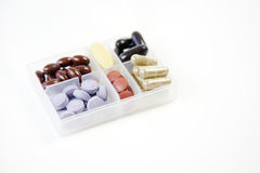 Pills and capsules. In a container Royalty Free Stock Image