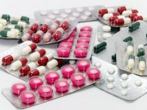 Pills and capsules. On white background Stock Image