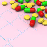 Pills and capsules on abnormal electrocardiogram (ECG) report Stock Photos