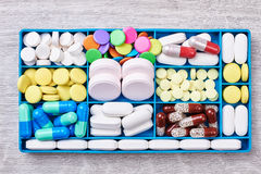 Pills and capsules in container. Stock Image