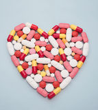 Pills and capsules in heart shape Royalty Free Stock Photo