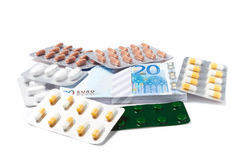 Pills capsules of medicament with money Stock Image