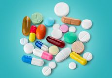 Pills and Capsules. Narcotic Medicine  White Color Image Recovery Stock Photo