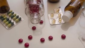 Pills and capsules on a table stock footage