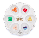 Pills, capsules and tablets on white plate Royalty Free Stock Photo