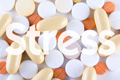 Pills and capsules with word stress Stock Image