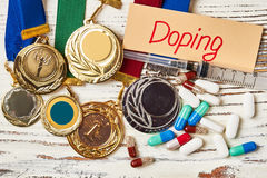Pills, card and medals. stock images