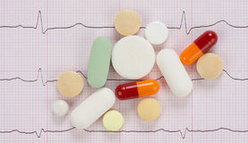 Pills and cardiogram Stock Photo